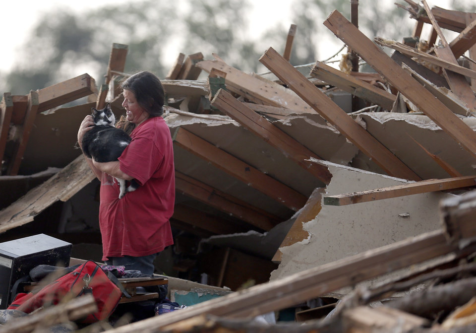 Lynda Stephens hugs, Sanchez, after finding him buried in the bedroom of their home in a residential area near the off Telephone Road in Moore following a deadly tornado, Monday, May 20, 2013. Photo by Sarah Phipps, The Oklahoman
