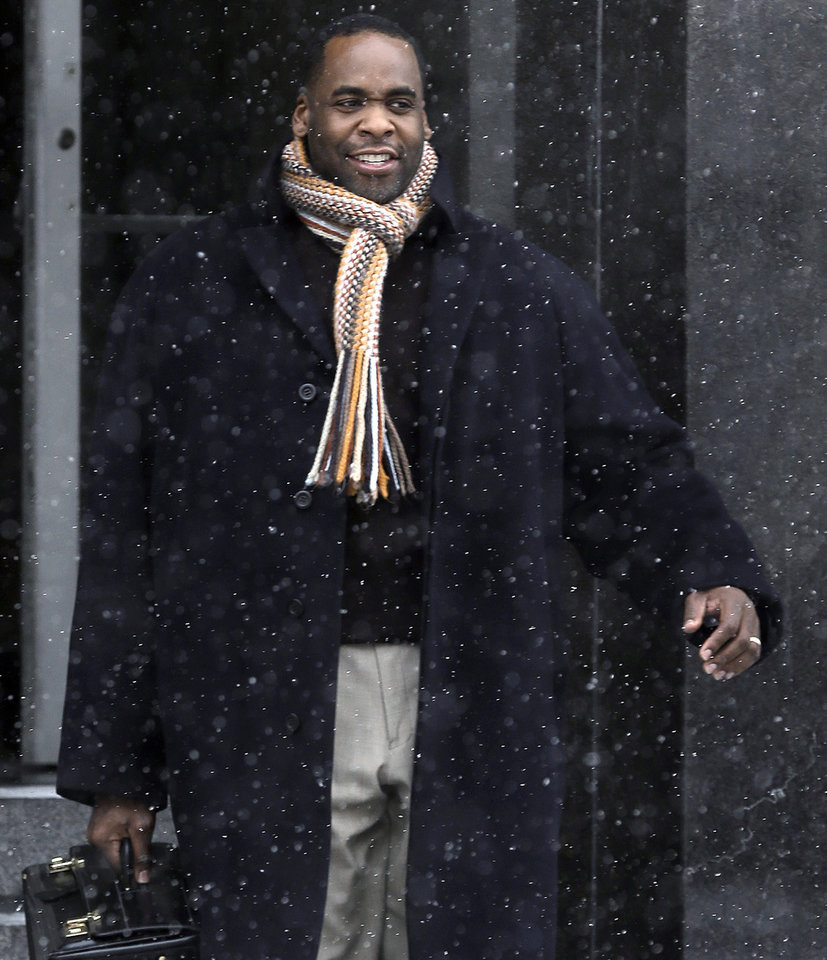 FILE - In this Jan 25, 2013 file photo, former Detroit Mayor Kwame Kilpatrick leaves federal court in Detroit. A court spokesman said Monday, March 11, 2013, that jurors have reached a verdict in Kilpatrick's corruption trial. (AP Photo/Paul Sancya, File)
