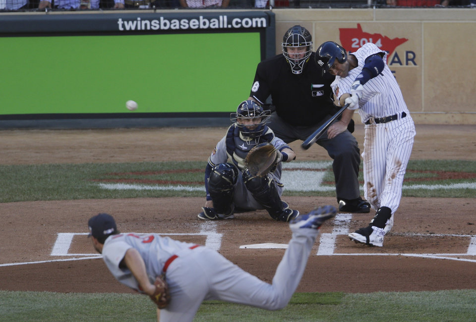 Photo - Shortstop Derek Jeter, of the New York Yankees, doubles during the first inning of the MLB All-Star baseball game, Tuesday, July 15, 2014, in Minneapolis. (AP Photo/Paul Sancya)