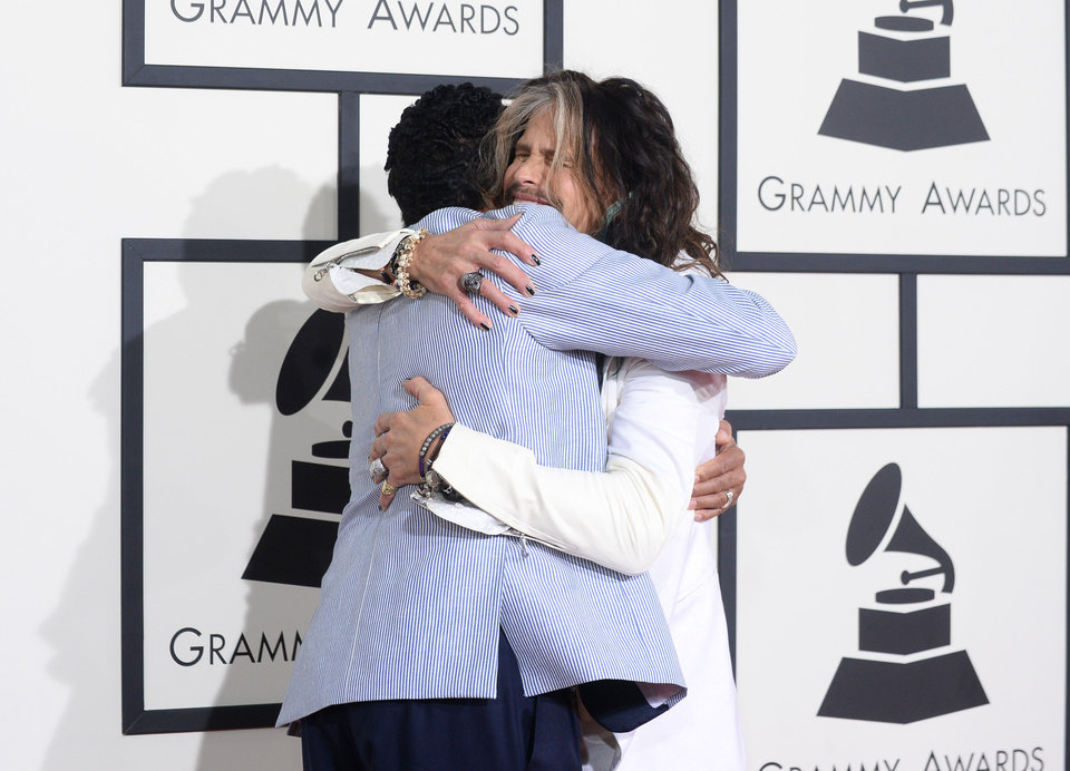 Photo - Smokey Robinson, left, and Steven Tyler arrive at the 56th annual Grammy Awards at Staples Center on Sunday, Jan. 26, 2014, in Los Angeles. (Photo by Jordan Strauss/Invision/AP)