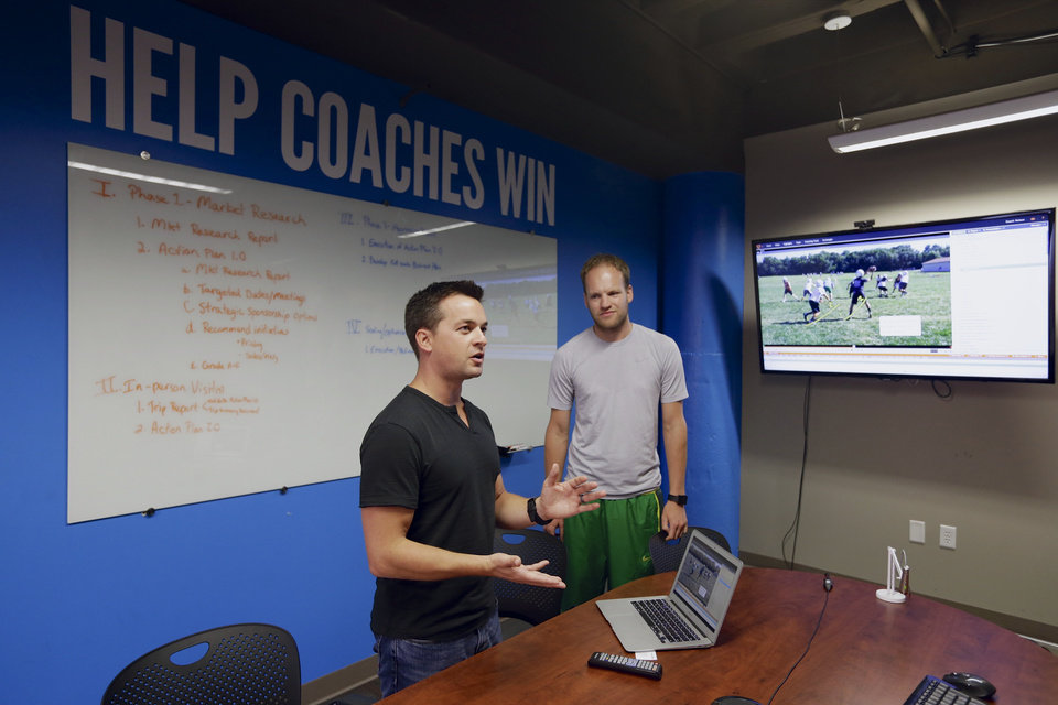 Photo - In this photo from Aug. 14, 2014, David Graff, CEO of Hudl, right, listens to John Wirtz, Chief Product Officer, in Lincoln, Neb. Hudl is a software company that has developed a way to immediately get game film to coaches after games and break down and separate different plays by type. (AP Photo/Nati Harnik)