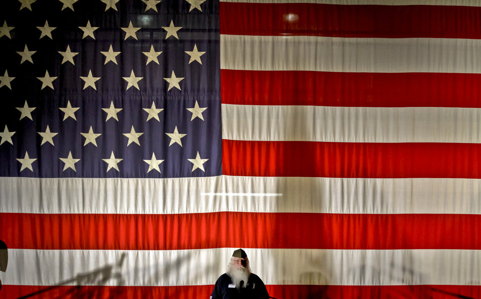 Billy May of the Oklahoma Veterans  School Flag Program speaks to students during Yukon High School's Veterans Day celebration on Monday. Photo by Chris Landsberger, The Oklahoman <strong>CHRIS LANDSBERGER - CHRIS LANDSBERGER</strong>