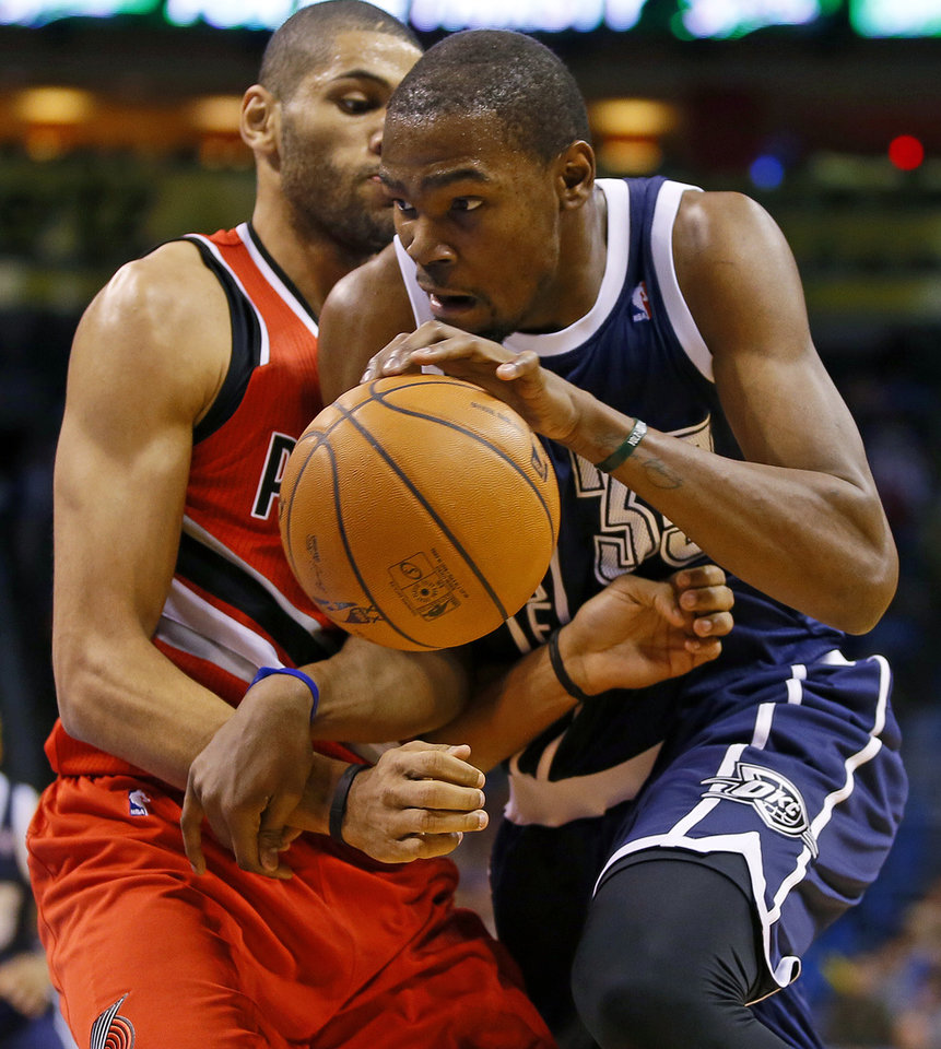 Photo - Oklahoma City's Kevin Durant (35) goes past Portland's Nicolas Batum (88) during an NBA basketball game between the Oklahoma City Thunder and the Portland Trail Blazers at Chesapeake Energy Arena in Oklahoma City, Tuesday, Dec. 31, 2013. Photo by Bryan Terry, The Oklahoman