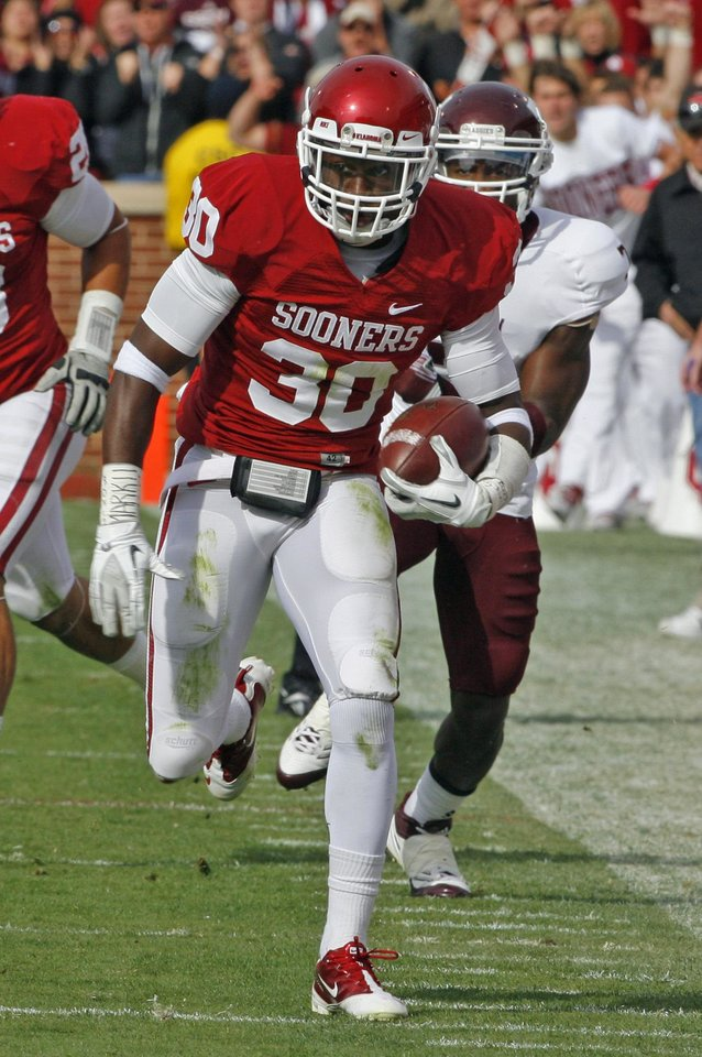 Oklahoma's Javon Harris (30) intercepts a pass during the first half of the college football game between the Texas A&M Aggies and the University of Oklahoma Sooners (OU) at Gaylord Family-Oklahoma Memorial Stadium on Saturday, Nov. 5, 2011, in Norman, Okla. Photo by Steve Sisney, The Oklahoman