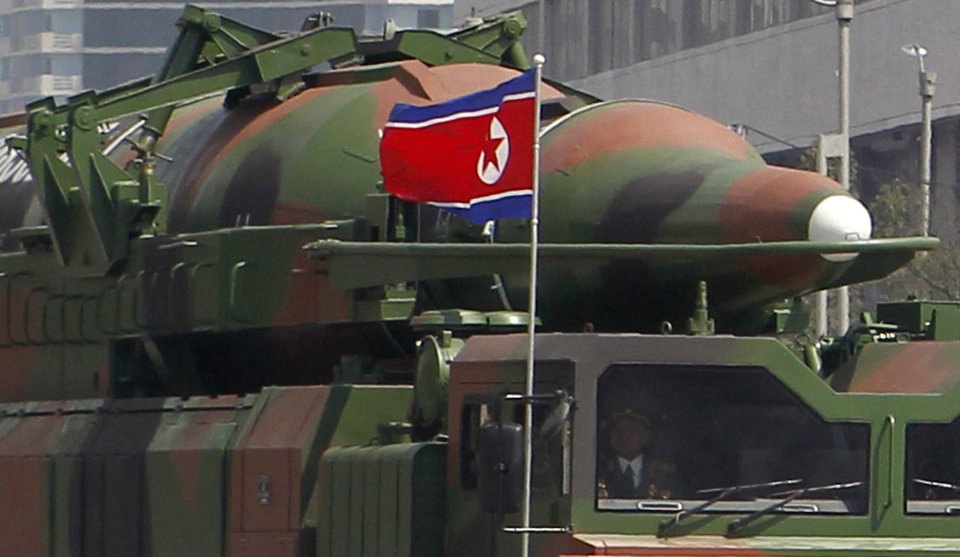 Photo -   In this photo taken Sunday, April 15, 2012, what appears to be a new missile is carried during a mass military parade at the Kim Il Sung Square in Pyongyang, North Korea, to celebrate the 100th anniversary of the country's founding father Kim Il Sung. The photo shows the warhead's surface is undulated, suggesting it's a thin metal sheet unable to withstand flight pressure, analysts say. Adding more doubt to North Korea's claims of military prowess after its flamboyant rocket launch failure, analysts say the half dozen missiles showcased at the military parade were low-quality fakes. (AP Photo/Ng Han Guan)