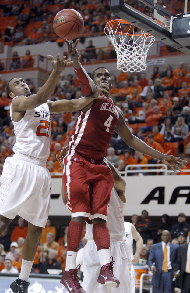 Photo - Oklahoma State's Markel Brown (22)Êand Oklahoma's Andrew Fitzgerald (4) fight for a rebound during the Bedlam men's college basketball game between the University of Oklahoma Sooners and Oklahoma State University Cowboys at Gallagher-Iba Arena in Stillwater, Okla., Saturday, February, 5, 2011. Photo by Sarah Phipps, The Oklahoman