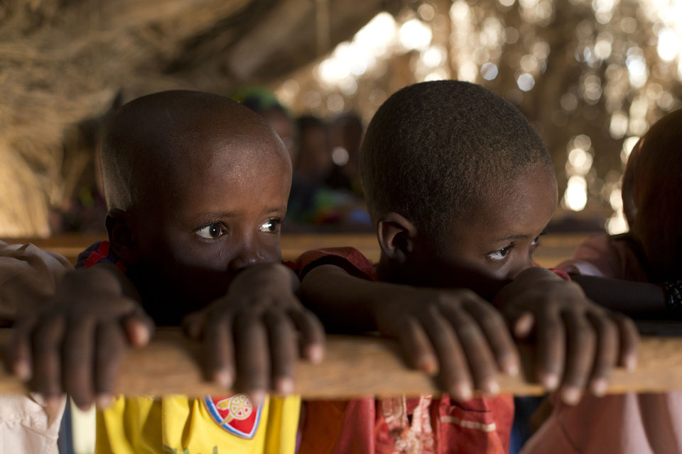 In this Nov. 2, 2012 photo, young students Youssouf, left, and Mahamat, struggle to pay attention during class, in the village of Louri, in the Mao region of Chad. A survey conducted in the country found that 51.9 percent of the children are stunted, one of the highest rates in the world, according to a summary published by UNICEF. Stunting is the result of having either too few calories, too little variety, or both. The struggle that is on display every day in the village\'s one-room schoolhouse reveals not only the staggering price that these children are paying, but also the price that it has exacted from Africa. (AP Photo/Rebecca Blackwell) ORG XMIT: NY876