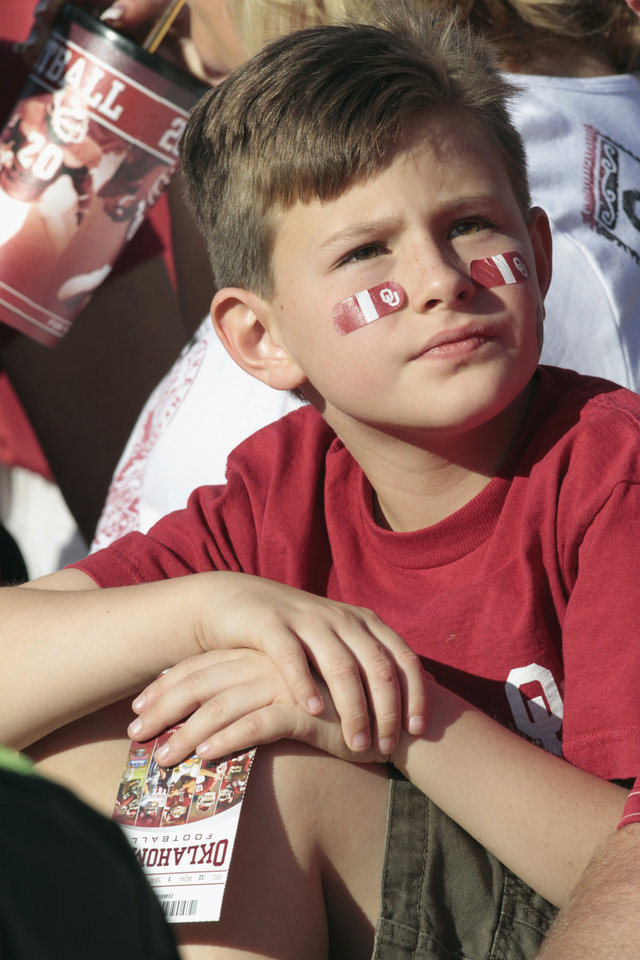 Cannon Cribley, 8, waits for the start of his first OU game between the University of Oklahoma Sooners (OU) and the Ball State Cardinals at Gaylord Family-Oklahoma Memorial Stadium on Saturday, Oct. 1, 2011, in Norman, Okla. Photo by Steve Sisney, The Oklahoman