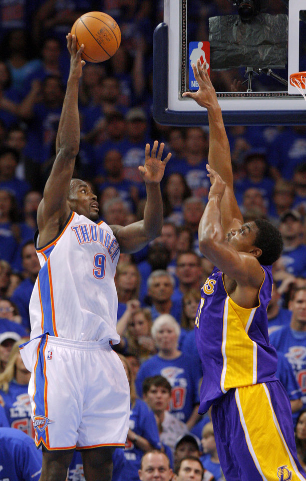 Oklahoma City's Serge Ibaka (9) puts up a shot over Los Angeles' Andrew Bynum (17) during Game 5 in the second round of the NBA playoffs between the Oklahoma City Thunder and the L.A. Lakers at Chesapeake Energy Arena in Oklahoma City, Monday, May 21, 2012. Photo by Bryan Terry, The Oklahoman