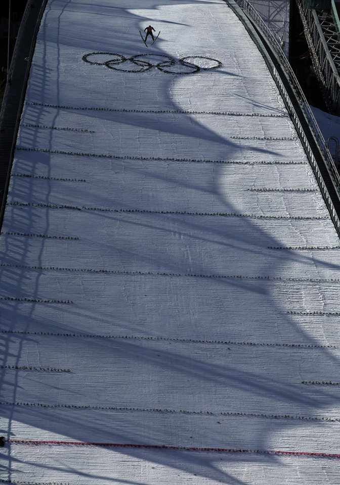 Photo - Russia's Evgeniy Klimov soars into the air  during the ski jumping large hill portion of the Nordic combined training at the 2014 Winter Olympics, Saturday, Feb. 15, 2014, in Krasnaya Polyana, Russia. (AP Photo/Gregorio Borgia)