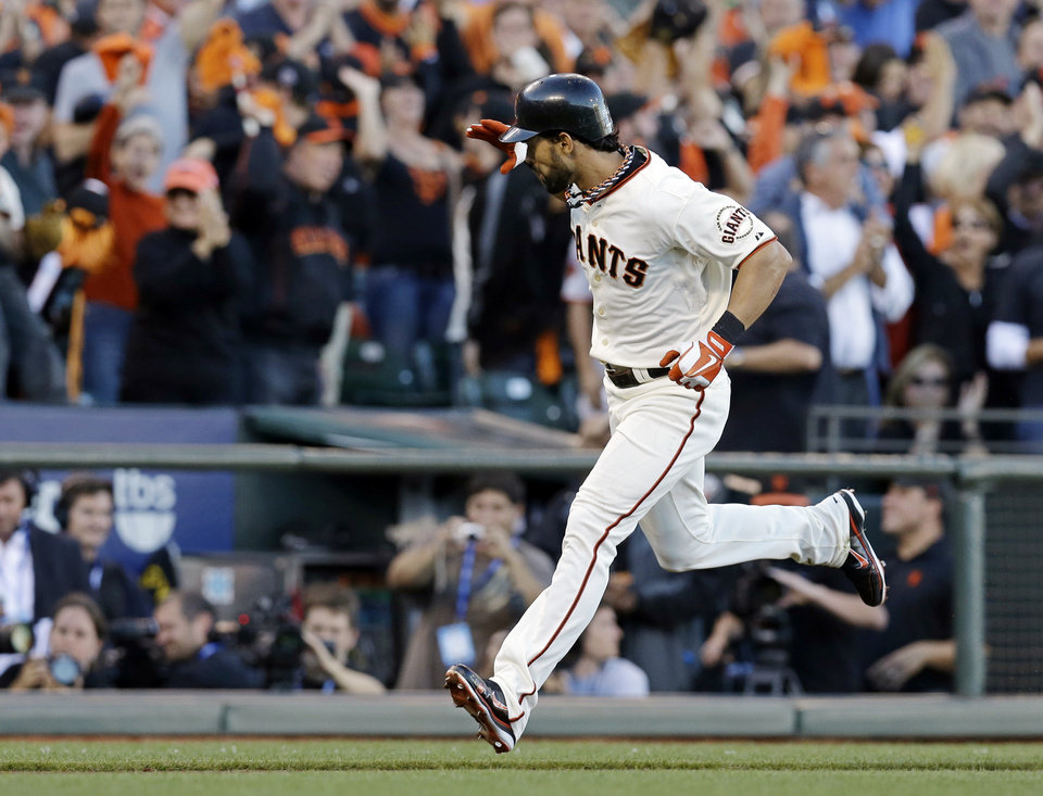 Photo -   San Francisco Giants' Angel Pagan reacts after hitting a home run during the first inning of Game 2 of baseball's National League championship series against the St. Louis Cardinals Monday, Oct. 15, 2012, in San Francisco. (AP Photo/David J. Phillip)