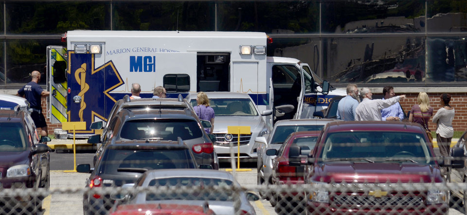 Photo - An ambulance sits outside the GM Marion Metal Center in Marion, Ind., following a chemical explosion Tuesday, July 1, 2014.  One worker died and five more were taken to Marion General Hospital with non-life threatening injuries.  (AP Photo/Chronicle-Tribune, Jeff Morehead)