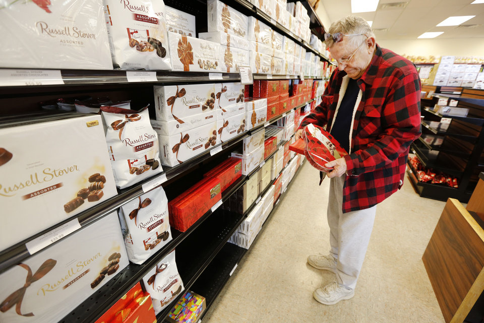 Richard Randal shops for Valentine�s Day chocolates for his wife Wednesday at Russell Stover in Oklahoma City. Photos by Steve Gooch, The Oklahoman