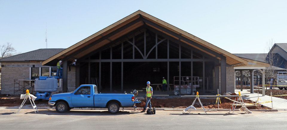 Photo - Workers renovate the former home of Crescent Market on the south side of Nichols Hills Plaza. Photo by NATE BILLINGS, The Oklahoman
