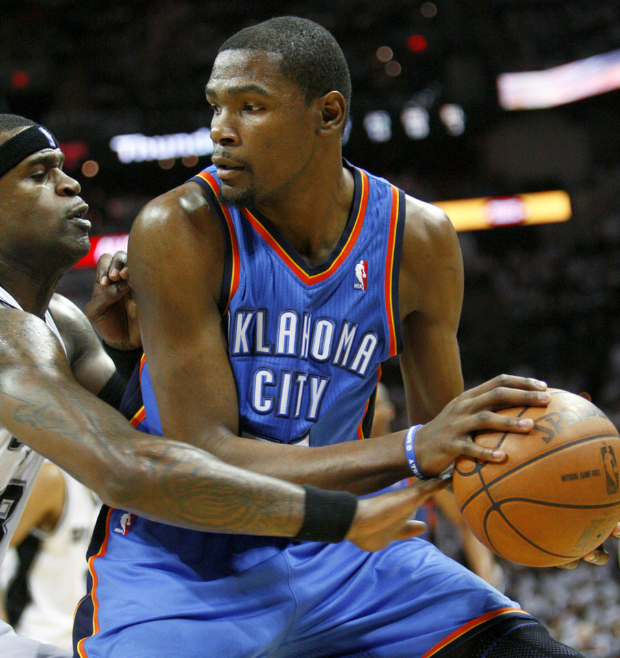 Photo - Oklahoma City's Kevin Durant (35) tries to get past San Antonio's Stephen Jackson (3) during Game 5 of the Western Conference Finals between the Oklahoma City Thunder and the San Antonio Spurs in the NBA basketball playoffs at the AT&T Center in San Antonio, Monday, June 4, 2012. Photo by Nate Billings, The Oklahoman