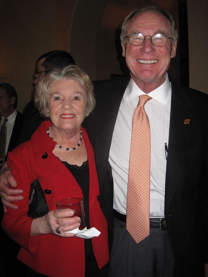 STAN HUPFELD'S PARTY....Dolly Flesher and Burns Hargis talk at the  party honoring Stan Hupfeld at Gaillaridia Golf and Country Club.  Stan is retiring as Integris Baptist CEO and President and will head  up the foundation board. (Photo by Helen Ford Wallace).