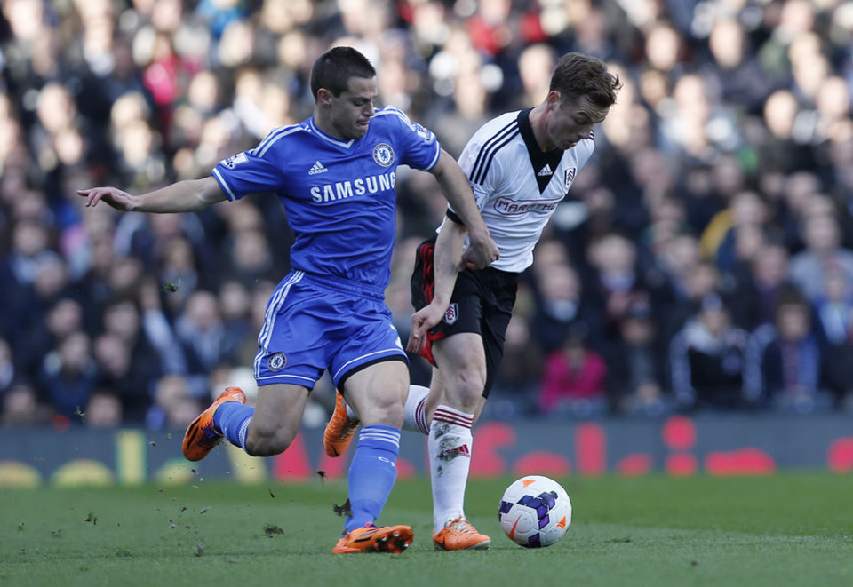 Photo - Fulham's Scott Parker, right, competes with Chelsea's Cesar Azpilicueta during their English Premier League soccer match at Craven Cottage, London, Saturday, March 1, 2014. (AP Photo/Sang Tan)