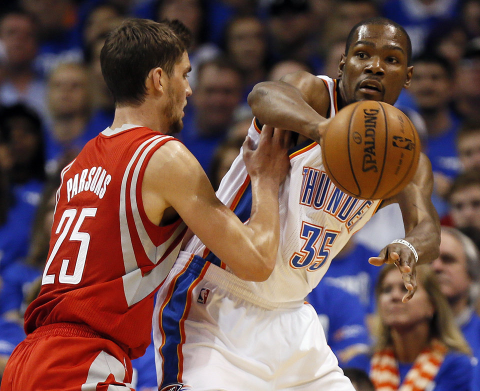 Oklahoma City's Kevin Durant (35) passes away from Houston's Chandler Parsons (25) during Game 1 in the first round of the NBA playoffs between the Oklahoma City Thunder and the Houston Rockets at Chesapeake Energy Arena in Oklahoma City, Sunday, April 21, 2013. Photo by Nate Billings, The Oklahoman
