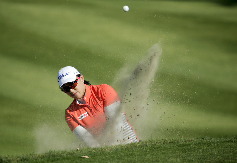 Photo - Amy Yang, of South Korea, hits from a bunker on the 15th hole during the first round at the Kraft Nabisco Championship golf tournament Thursday, April 3, 2014, in Rancho Mirage, Calif. (AP Photo/Chris Carlson)