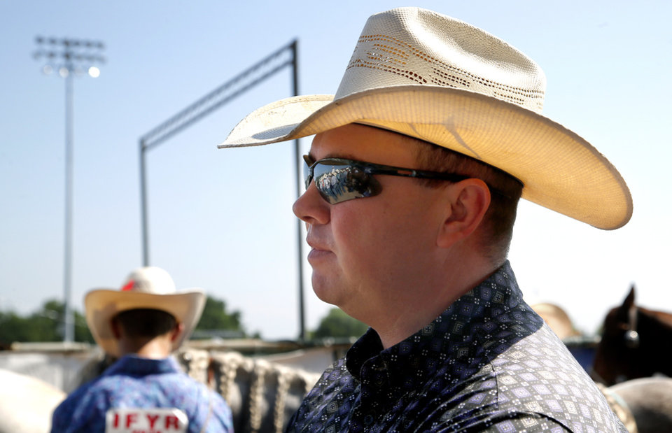 Photo -  Dodge City Community College coach Gabe Burrows watches contestants at the International Finals Youth Rodeo in Shawnee. Burrows is looking for talented youngsters who might want to consider going to school and competing for Dodge City. [SARAH PHIPPS/THE OKLAHOMAN]