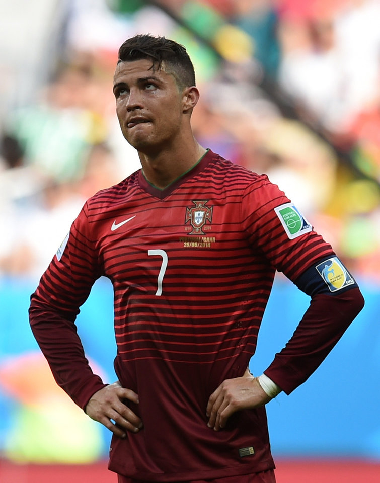 Photo - Portugal's Cristiano Ronaldo stands with hands on hips during the group G World Cup soccer match between Portugal and Ghana at the Estadio Nacional in Brasilia, Brazil, Thursday, June 26, 2014.  Portugal won 2-1 but were eliminated from the competition.  (AP Photo/Paulo Duarte)