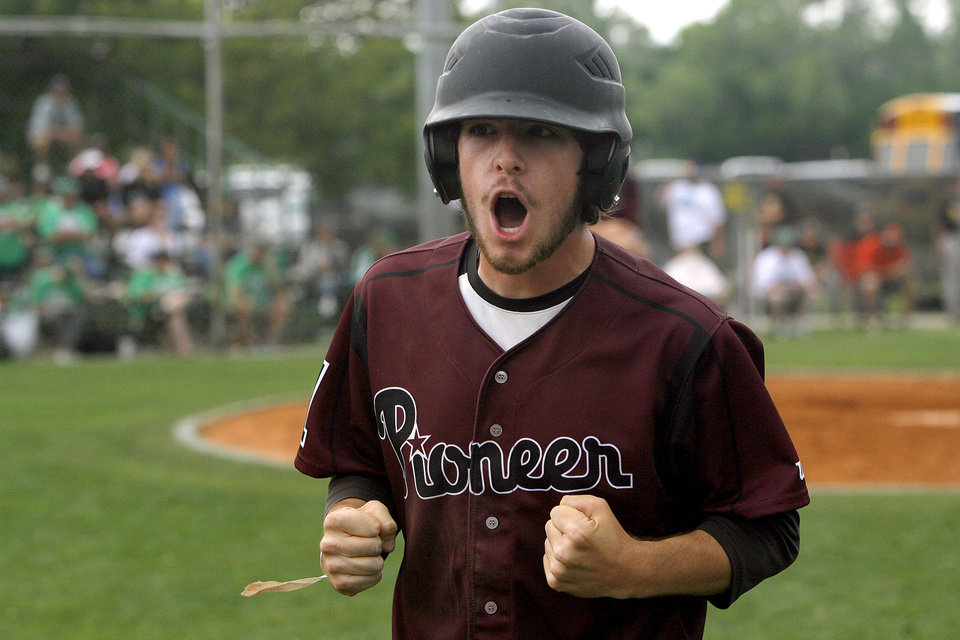 Photo - HIGH SCHOOL BASEBALL / STATE TOURNAMENT / CELEBRATION: Pioneer's Tanner Leon celebrates a score during the high school Class A baseball playoff game between Rattan and Pioneer at Dolese Park in Oklahoma City, Friday, May 4, 2012. Photo by Sarah Phipps, The Oklahoman