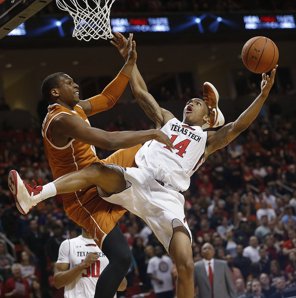 Photo - Texas Tech's Robert Turner is fouled by Texas' Jonathan Holmes during an NCAA college basketball game in Lubbock, Texas, Saturday, March 8, 2014. (AP Photo/Lubbock Avalanche-Journal, Zach Long) LOCAL TV OUT