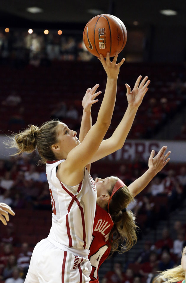 Photo - Oklahoma's Morgan Hook (10) shoots a basket as Marist's Casey Dulin (14) defends during the women's college basketball game between the University of Oklahoma and Marist at Lloyd Noble Center in Norman, Okla.,  Sunday,Dec. 2, 2012. Photo by Sarah Phipps, The Oklahoman