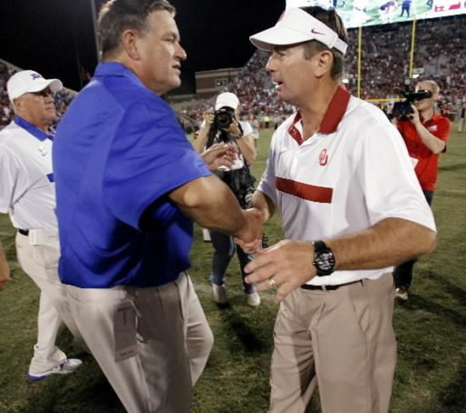 Photo - Tulsa head coach Bill Blankenship and Oklahoma head coach Bob Stoops shake hands after the college football game between the University of Oklahoma Sooners ( OU) and the Tulsa University Hurricanes (TU) at the Gaylord Family-Memorial Stadium on Saturday, Sept. 3, 2011, in Norman, Okla. Photo by Steve Sisney, The Oklahoman ORG XMIT: KOD