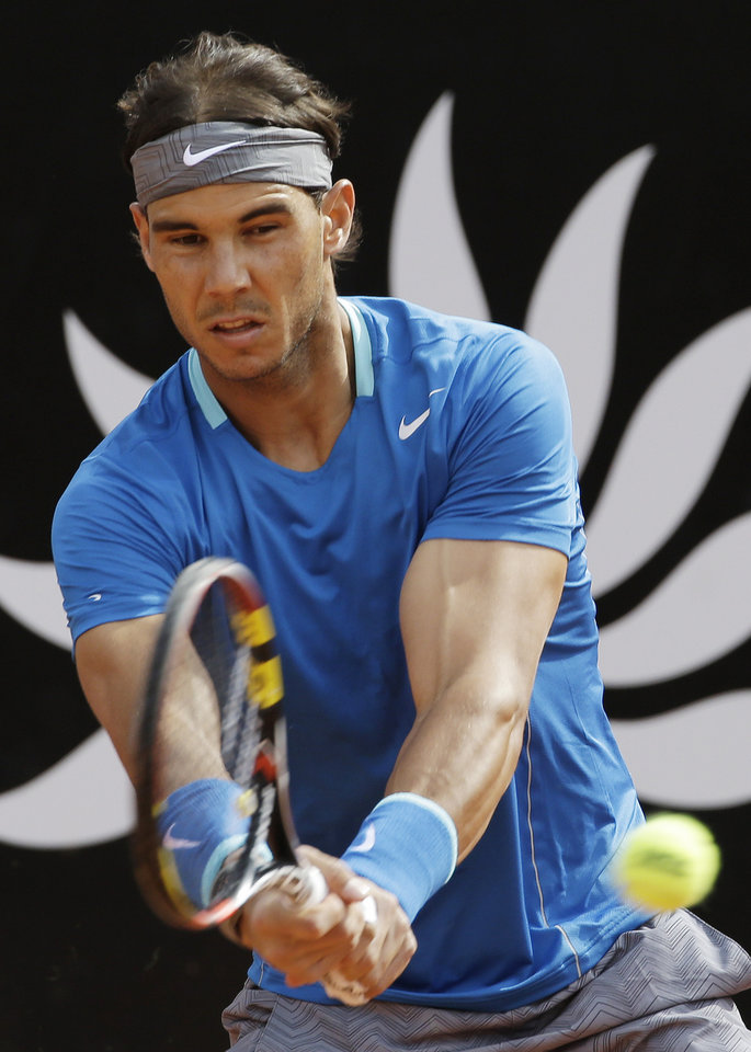 Photo - Spain's Rafael Nadal returns a backhand to Serbia's Novak Djokovic during their final match at the Italian Open tennis tournament, in Rome, Sunday, May 18, 2014. (AP Photo/Andrew Medichini)