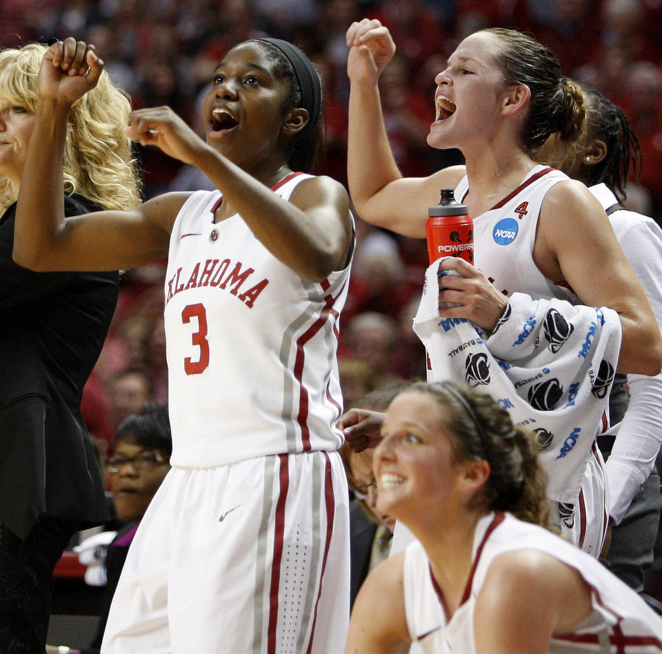 Oklahoma's Aaryn Ellenberg (3) and Whitney Hand (25) celebrate during a first round game of the NCAA women's basketball tournament between the University of Oklahoma Sooners and the Michigan Wolverines at Lloyd Noble Center in Norman, Okla., Sunday, March 18, 2012. Oklahoma won 88-67. Photo by Bryan Terry, The Oklahoman
