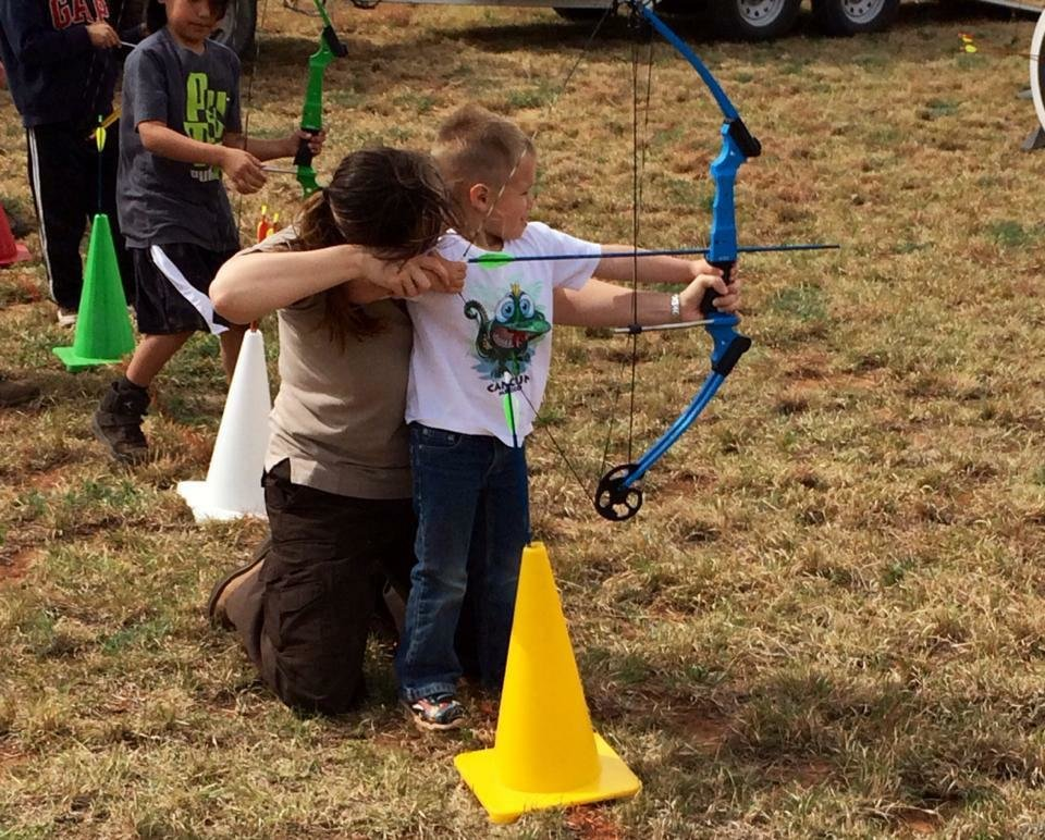 Photo -  Kids can learn to shoot a bow and arrow at Saturday's anniversary celebration at the Washita Wildlife National Refuge in western Oklahoma.