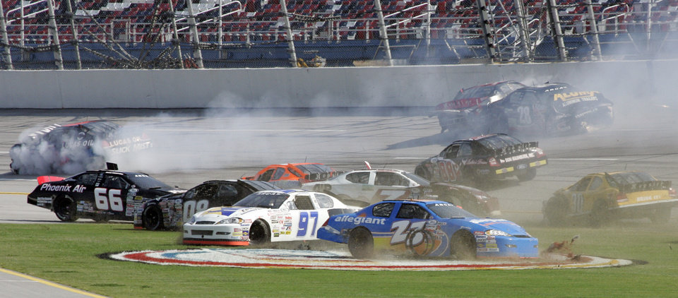 Photo -   Drivers including Mark Thompson (66), Donnie Neuenberger (97), Spencer Gallagher (23), George Cushman (7) and Drew Charlson (28) wreck during the International Motorsports Hall of Fame 250 ARCA auto race at Talladega Superspeedway in Talladega, Ala., Friday, May 4, 2012. (AP Photo/Craig Hellmann)