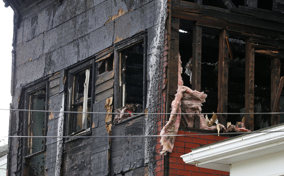 Photo - The top floor of a three-story home is shown on Pierce Street where two adults and four children were found dead early Monday, May 13, 2013, after a late night fire engulfed the home, in Pottsville, Pa. A fire marshal was sifting through the debris Monday and authorities were searching for the cause. (AP Photo/Rich Schultz)