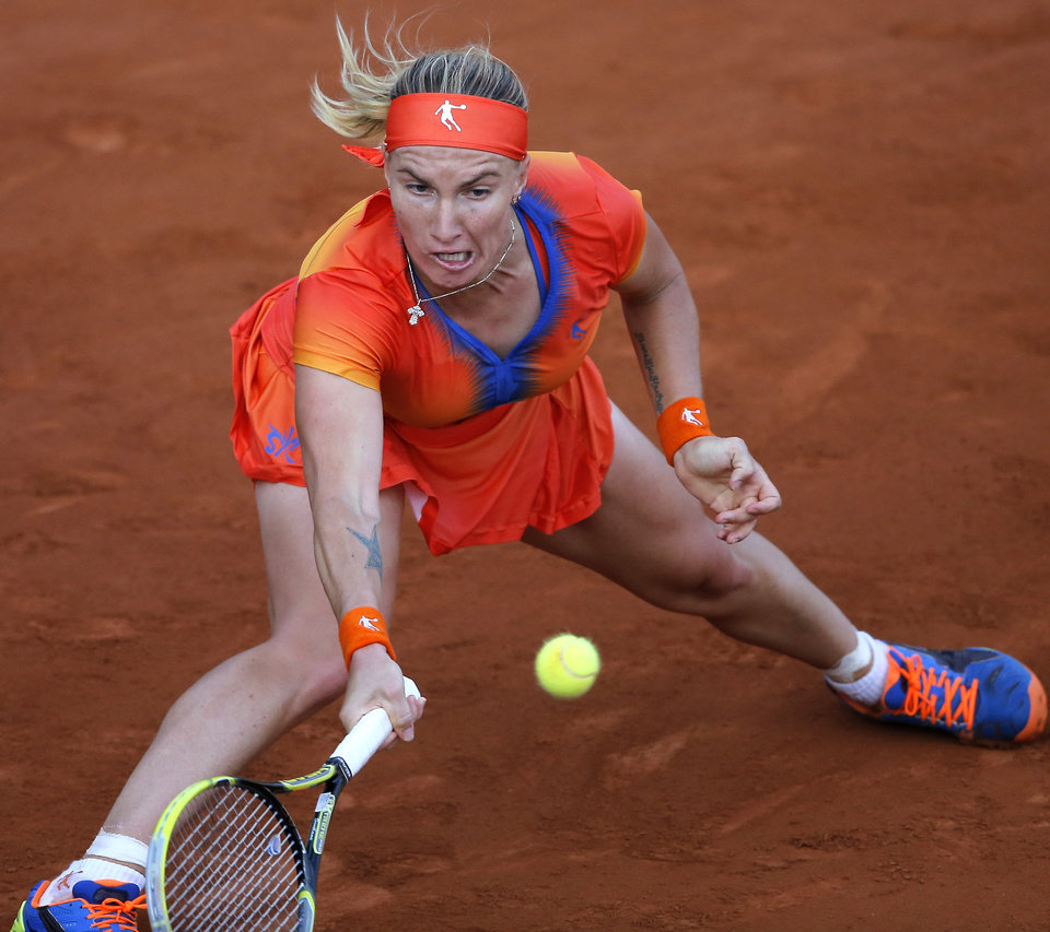 Photo - Russia's Svetlana Kuznetsova returns the ball during the fourth round match of the French Open tennis tournament against Lucie Safarova of the Czech Republic at the Roland Garros stadium, in Paris, France, Monday, June 2, 2014. Kuznetsova won in two sets 6-3, 6-4. (AP Photo/Michel Spingler)