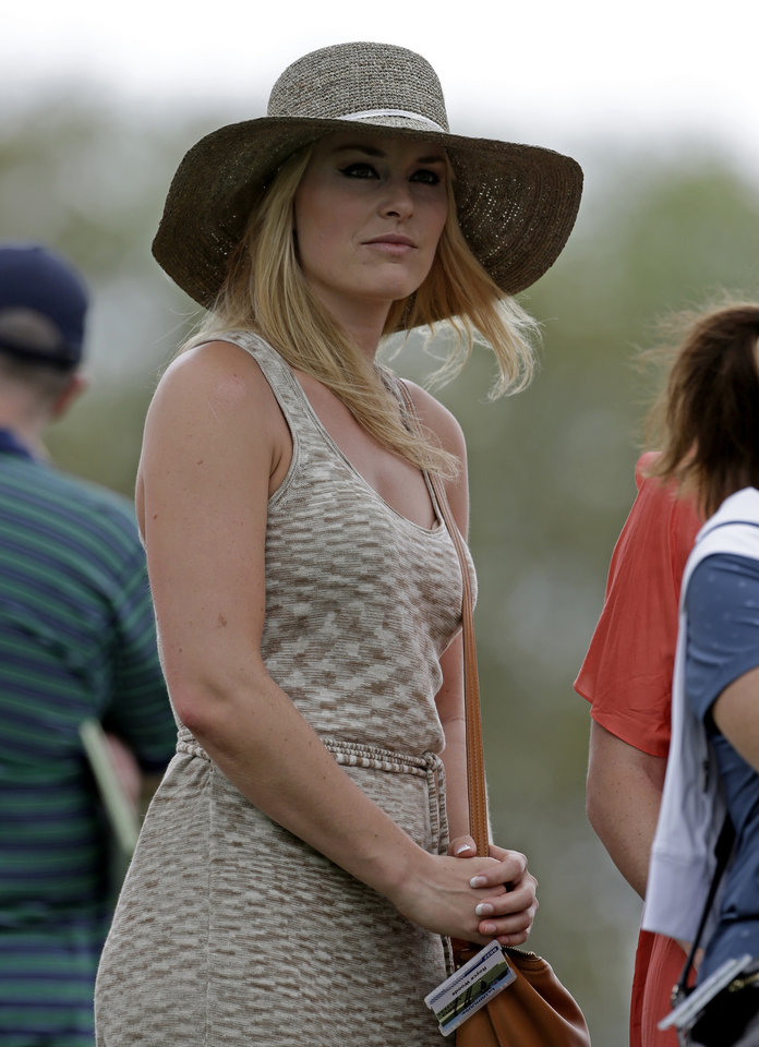 Photo - Skier Lindsey Vonn watches Tiger Woods during the first round of the Masters golf tournament Thursday, April 11, 2013, in Augusta, Ga. (AP Photo/Darron Cummings)