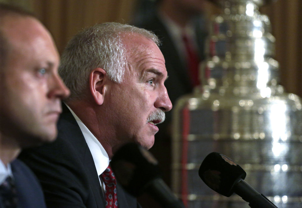 Photo - Chicago Blackhawks coach Joel Quenneville, right, speaks during a news conference Friday, July 26, 2013 in Chicago, accompanied by Vice President/General Manager Stan Bowman. The Blackhawks announced an agreement that will keep the two-time Stanley Cup winning head coach with the team through through the end of the 2016-17 National Hockey League season. (AP Photo/M. Spencer Green)