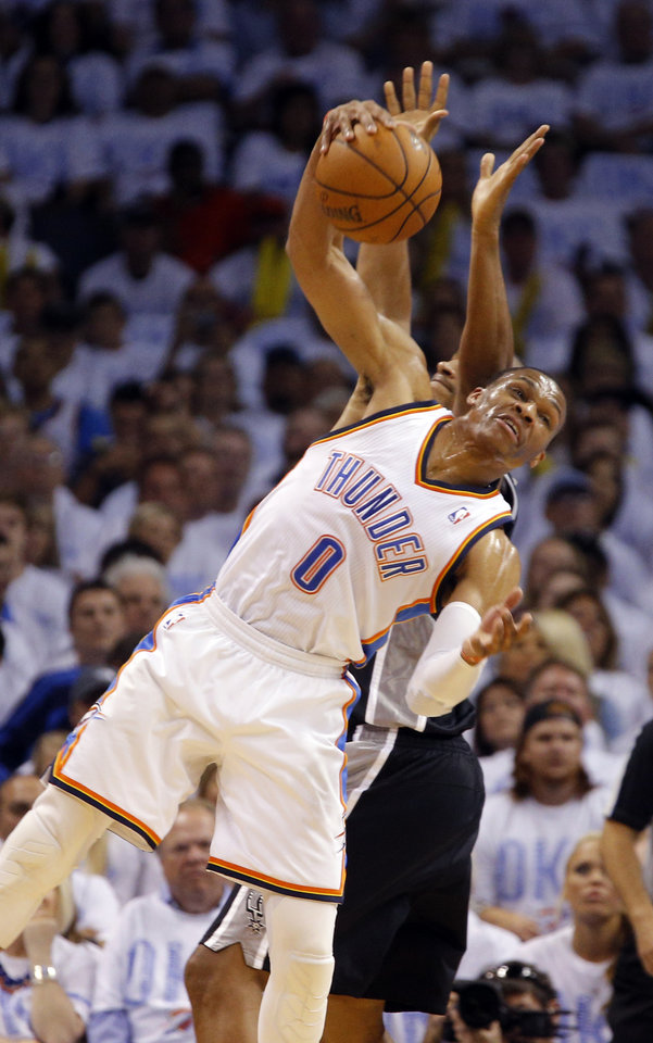 Photo - Oklahoma City's Russell Westbrook (0) steals a pass intended for Boris Diaw (33) during Game 6 of the Western Conference Finals in the NBA playoffs between the Oklahoma City Thunder and the San Antonio Spurs at Chesapeake Energy Arena in Oklahoma City, Saturday, May 31, 2014. Photo by Bryan Terry, The Oklahoman