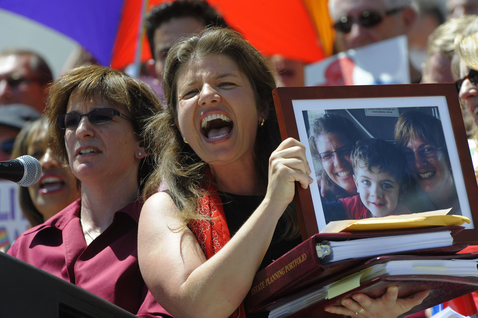 Photo -   Fran, left, and Anna Simon, holding a photograph of the couple and their son, Jeremy, address the crowd during a rally supporting civil unions at the Denver City and County Building in Denver, Thursday, May 3, 2012. The rally took place prior to the House Judiciary Committee hearing on Senate Bill 2 at the State Capitol. The Colorado Civil Union Act recently passed the Senate with bipartisan support. The bill would allow same sex couple to enter into civil union. (AP Photo/The Denver Post, Craig F. Walker) MAGS OUT; TV OUT; INTERNET OUT