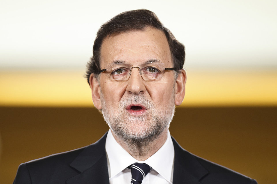Photo - Spain's Prime Minister Mariano Rajoy delivers a statement in the Moncloa Palace, Madrid, Spain, Monday, June 2, 2014. Spanish Prime Minister Mariano Rajoy announced in the press conference that King Juan Carlos plans to abdicate and pave the way for his son, Crown Prince Felipe, to become the country's next king. The 76-year-old Juan Carlos oversaw his country's transition from dictatorship to democracy but has had repeated health problems in recent years. His popularity also dipped following royal scandals, including an elephant-shooting trip he took in the middle of Spain's financial crisis that tarnished the monarch's image. The king came to power in 1975, two days after the death of longtime dictator Francisco Franco. (AP Photo/Daniel Ochoa de Olza)