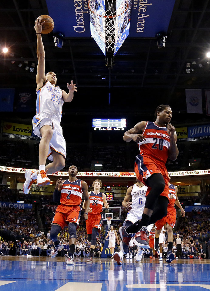 Photo - Oklahoma City's Kevin Martin (23) goes to the basket beside Washington's Cartier Martin (20) during an NBA basketball game between the Oklahoma City Thunder and the Washington Wizards at Chesapeake Energy Arena in Oklahoma City, Wednesday, March 19, 2013. Oklahoma City won 103-80. Photo by Bryan Terry, The Oklahoman