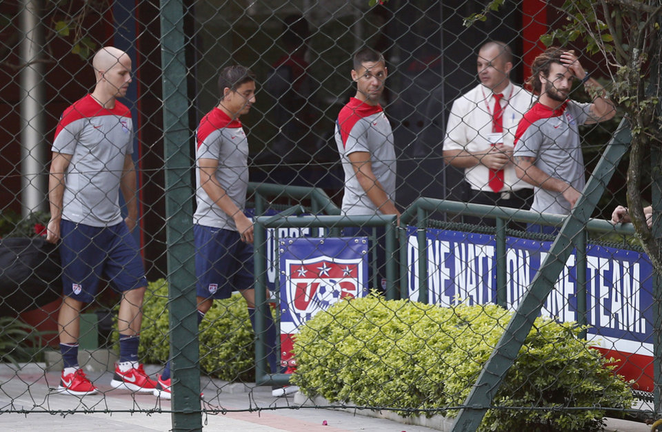 Photo - United States' Clint Dempsey, center right, walks with teammates, from left, Michael Bradley, Alejandro Bedoya and Kyle Beckerman to an indoor workout during a training session in Sao Paulo, Brazil, Tuesday, June 17, 2014.  The United States will play against Portugal in group G of the 2014 soccer World Cup on June 22. (AP Photo/Julio Cortez)