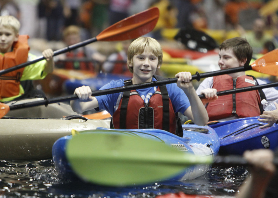 Photo - Thirteen year old Jake Seay, from Cheyenne Middle School in Edmond, paddles a Kayak during school day of the Oklahoma Wildlife Expo at the Lazy E Arena and Ranch in Guthrie, OK, Friday, September 28, 2012,  By Paul Hellstern, The Oklahoman