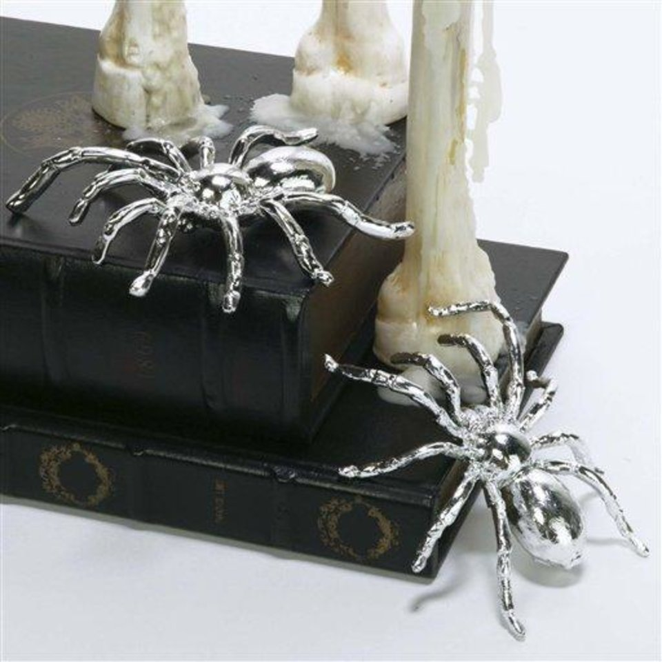 Photo - This product image released by Z Gallerie shows their little metallic spiders. This season you'll find lots of ghoulish yet glamorous pieces to decorate with for Halloween.   (AP Photo/Z Gallerie)