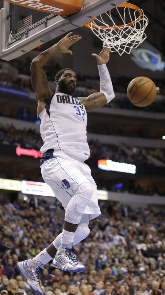 Photo - Dallas Mavericks guard O.J. Mayo (32) scores during the second half of an NBA basketball game against the Golden State Warriors Saturday, Feb. 9, 2013, in Dallas. The Mavericks won 116-91. (AP Photo/LM Otero)