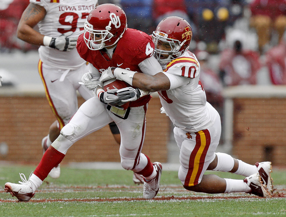 Oklahoma\'s Kenny Stills (4) is brought down by Iowa State\'s Jacques Washington (10) during a college football game between the University of Oklahoma Sooners (OU) and the Iowa State University Cyclones (ISU) at Gaylord Family-Oklahoma Memorial Stadium in Norman, Okla., Saturday, Nov. 26, 2011. Photo by Bryan Terry, The Oklahoman