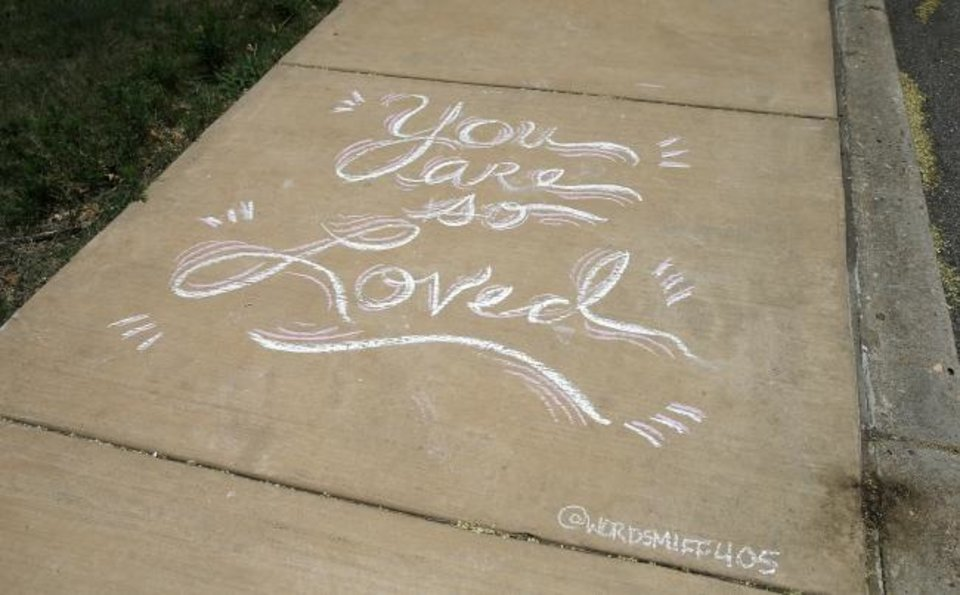 Photo -  A quote wrote in chalk is seen on July 23  on a sidewalk in Edgemere Park in Oklahoma City. Oklahoma City artist Nicole Poole creates chalk messages and drawings in the park. [Bryan Terry/The Oklahoman Archives]
