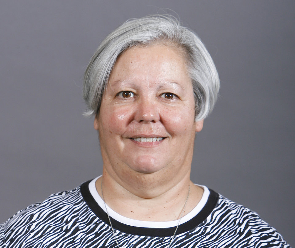 Photo - DeeAnn Wallar, Edmond North, tennis coach, poses for a mug at The Oklahoman's Spring high school sports photo day, Wednesday, Feb. 16, 2011, at the OPUBCO building in Oklahoma City. Photo by Sarah Phipps, The Oklahoman  ORG XMIT: KOD