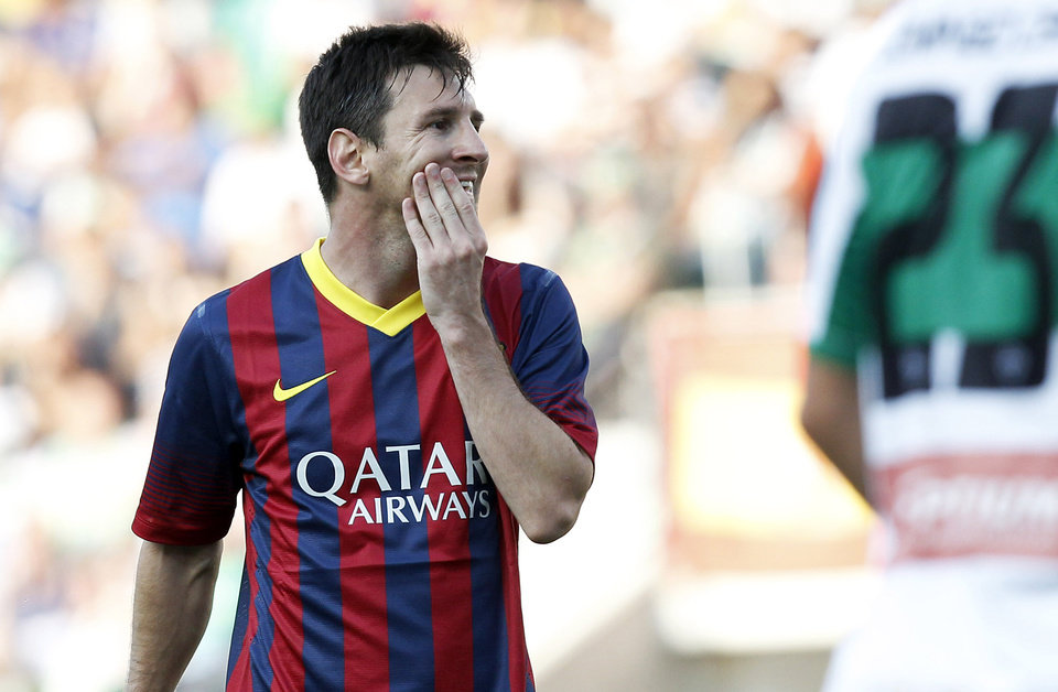 Barcelona's Lionel Messi from Argentina reacts after failing to score against Elche during a Spanish La Liga soccer match at the Martinez Valero stadium in Elche, Spain, on Sunday, May 11, 2014. (AP Photo/Alberto Saiz)