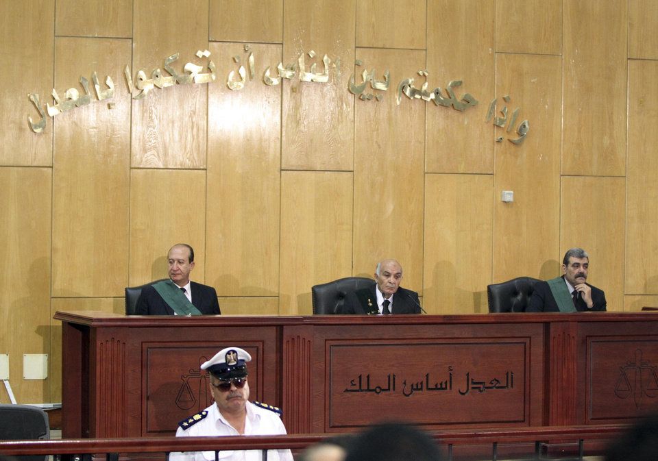 Photo -   Judges participate in the trial of Alaa and Gamal Mubarak, sons of outsted President Hosni Mubarak, on charges of insider trading, in a courtroom in Cairo, Egypt, Monday, July 9, 2012. The sons of ousted Egyptian leader Hosni Mubarak, one-time heir apparent Gamal and wealthy businessman Alaa, went on Trial on Monday charged with insider trading. The trial was adjoruned until Sept. 8 to allow defense lawyers to familiarize themselves with the case. The court also denied a request by the defense for the release on bail of the Mubarak sons. (AP Photo/Ahmed Gomaa)